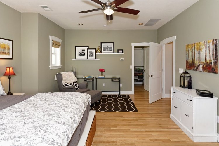Master bedroom staged to sell