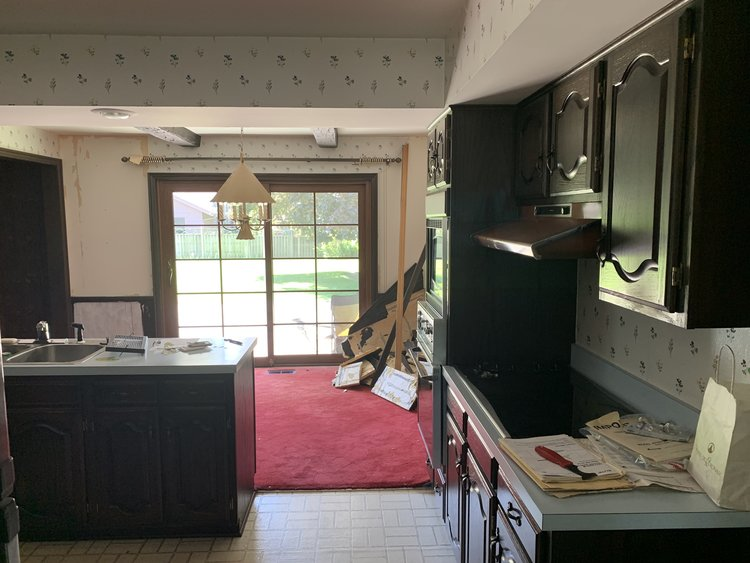 There is a header hidden in the soffit in the center of the kitchen.