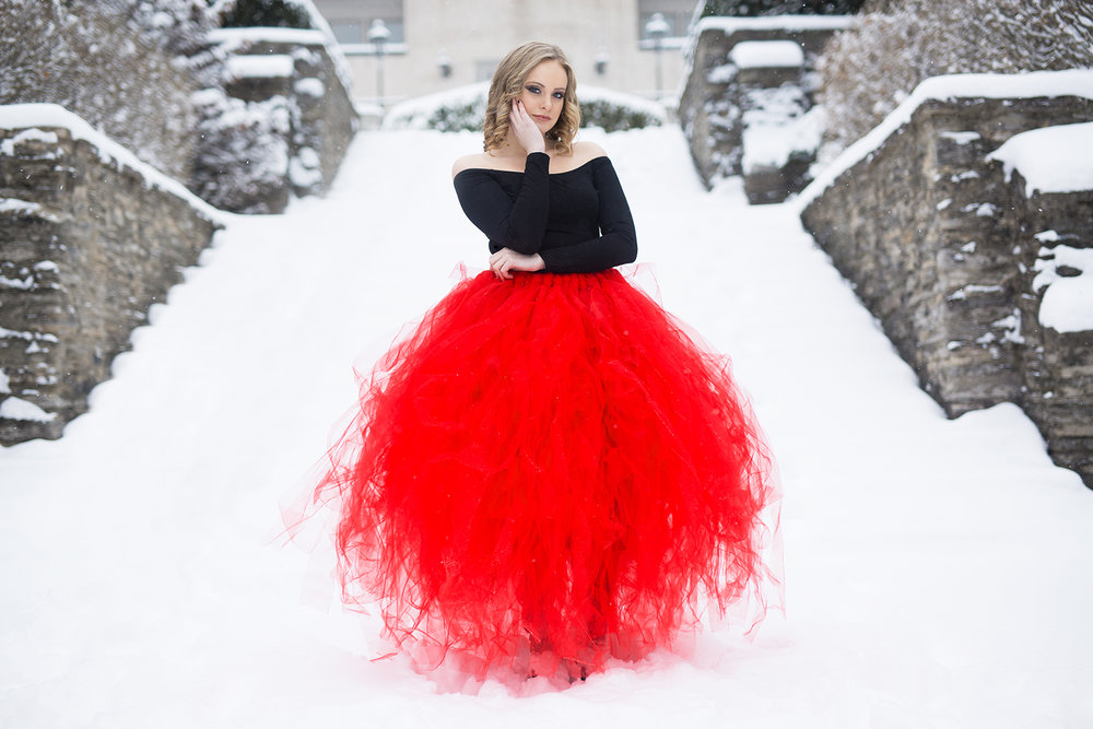 Senior girl in a red tulle skirt in front of Jeffrey Park Mansion in Bexley, a suburb of Columbus, Ohio.