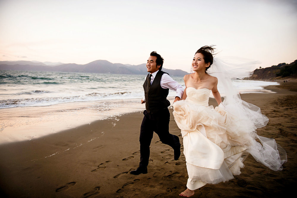 Pre Wedding Bride and groom running at Baker Beach