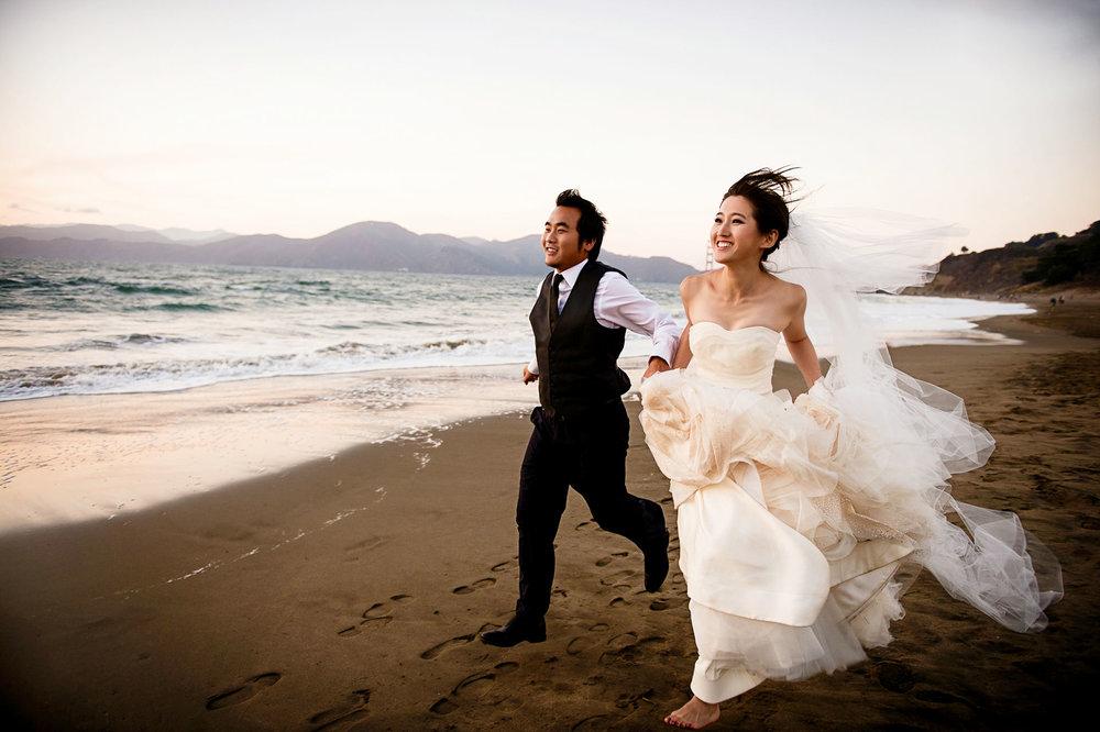 Pre Wedding Bride and groom running at Baker Beach