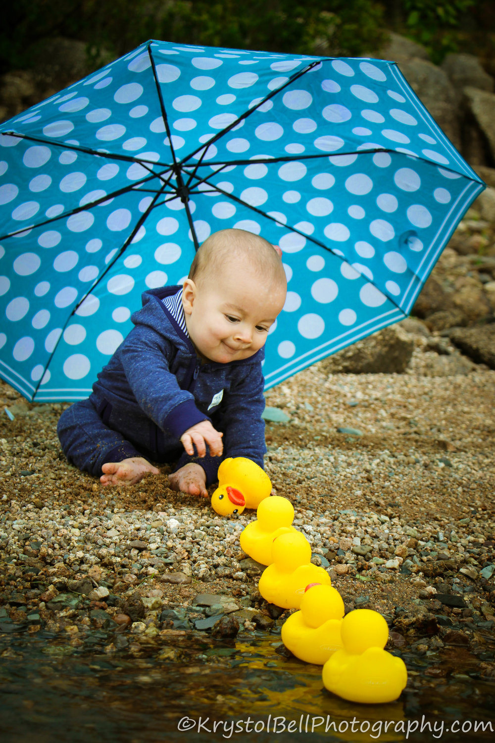 Baby Huddy getting all his ducks in a row... or maybe getting them out of a row is more accurate!  I had been wanting to do a rubber duck/umbrella photo for a while and he did a very cute job of it!