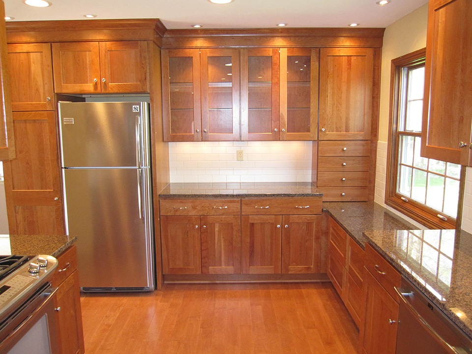 white-backsplash-tiles-red-cabinets.jpg
