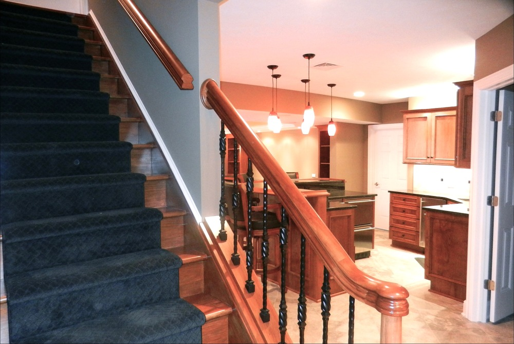 staircase-custom-kitchen-downstairs-wood-cabinets.jpg