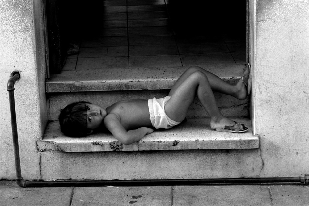 Resting child, Camagüey, Cuba.