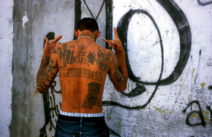 A member of Mara Salvatrucha (MS-13) shows off his tattoos, El Salvador.