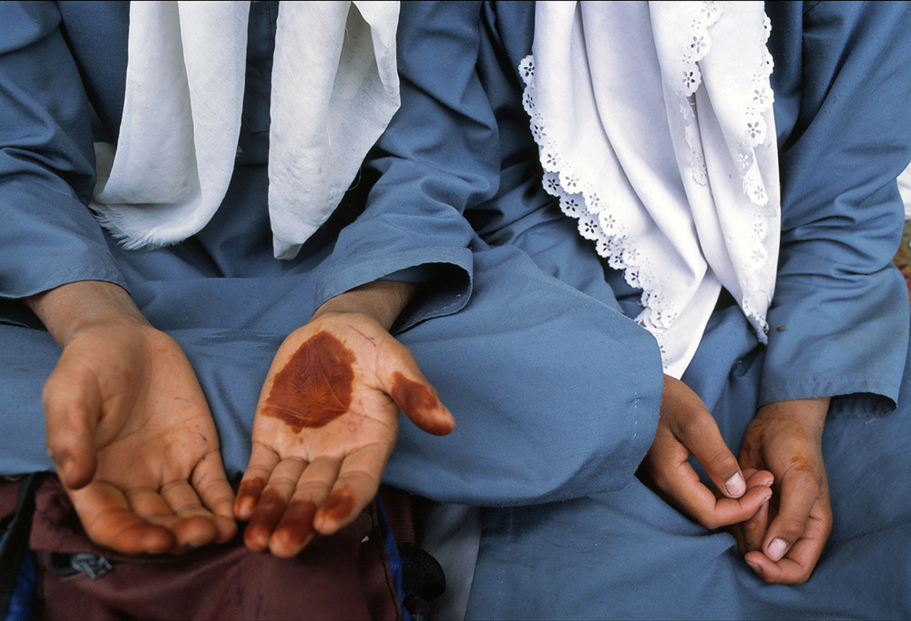 School girls with henna on their palms, Kashmir.
