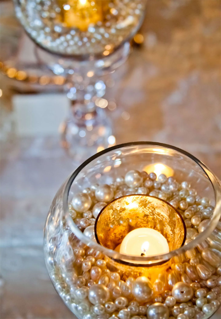 Timeless elegance. Give your wedding a glamorous feel with this pearl centerpiece.