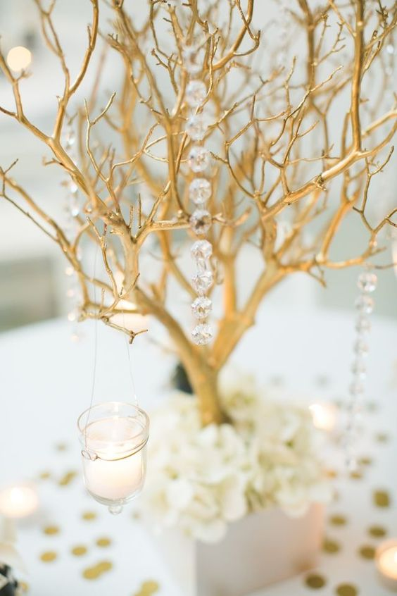 Fairy-tale come true. Give your wedding an elegant look by combining painted branches and crystals