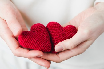 crop-hands-with-knitted-hearts_23-2147736882.jpg
