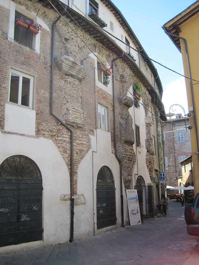 Houses built into the walls of the Roman amphitheatre – Lucca