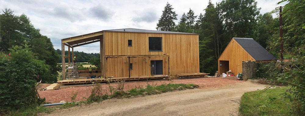 Devon-House-Passivhaus-Prewett-Bizley-Architects-loggia-porch-larch.jpg