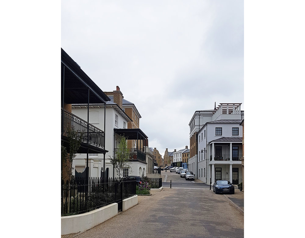 Poundbury-Dorset-Architect-housing-vernacular-georgian-balcony-veranda-street.jpg