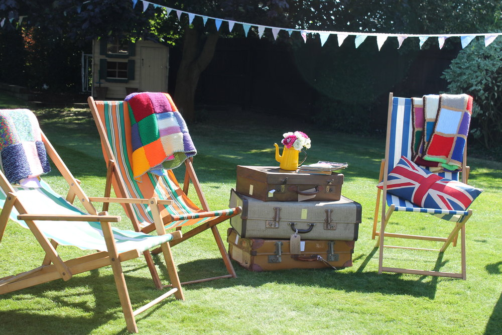 Deckchairs and cases to put your drinks.JPG