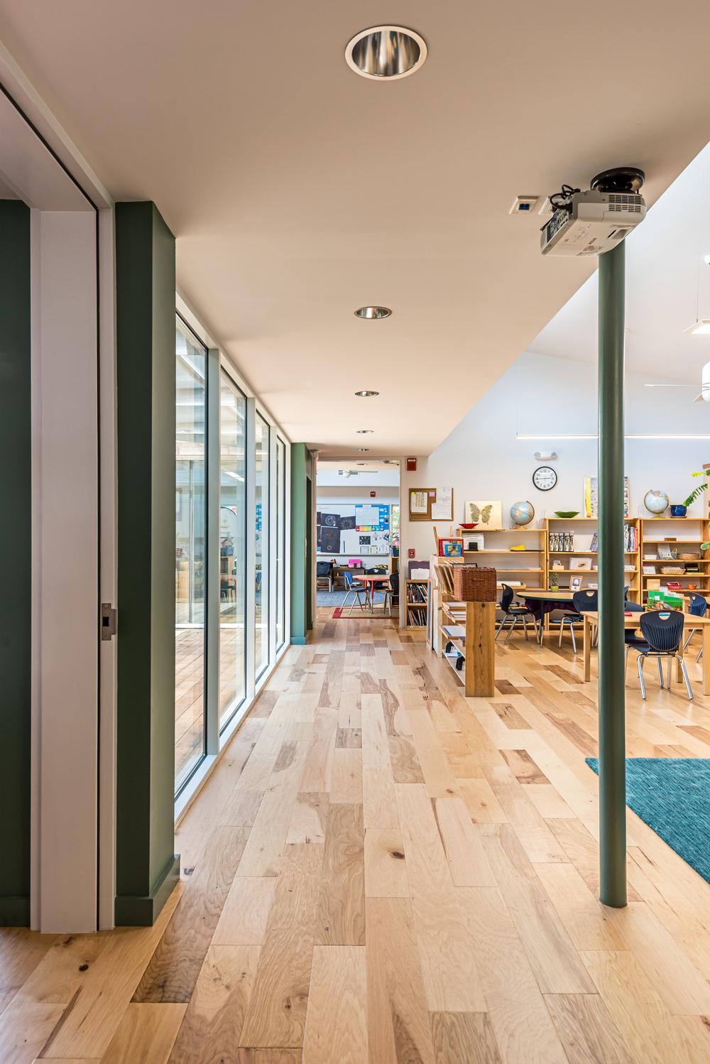 The classrooms are all directly connected with oversized doors to give the teachers the option of expanding the spaces into each other. When it is time to focus, teachers can close the doors, and isolate each space.