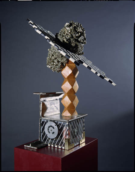 1987    Pyrite, wood, steel, motorized gears, internal neon, plastic    28 x 4 x 11 Inches