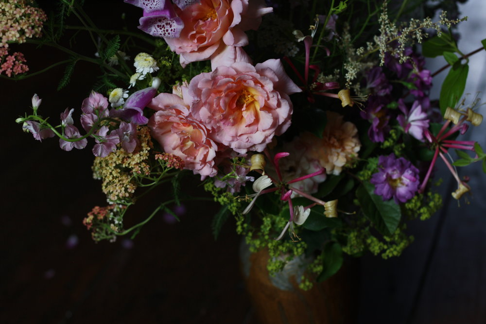 floral arrangement with rosa 'Compassion, Veilchenblau rose, 'Felicia' rose, honeysuckle and astilbe.