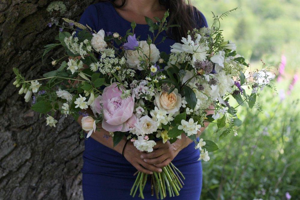 Halifax, NS wedding florist. June bridal bouquet featuring wildflowers, Crocus rose, Marie Pavier rose, Alba maxima rose, Pilgrim rose, peonies, mock orange, foxglove, peas on the vine, campanula, vetch, filipendula vulgaris and astrantia.