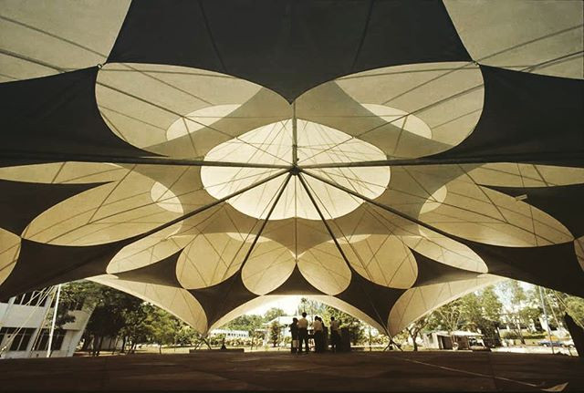 This prototype by #Stuttgart based SL-Rasch beautifully showcases how patterning and layered membranes add to the aesthetic of tensile membrane architecture while increasing performance. This Assembly Tent was built in 1999 in Kuala Lampur/Malaysia and is claimed to be easy to erect without use of a crane, and can be modularly adjusted to cover large areas. The multiple layers minimize solar gain and provide ventilation to ensure a constantly cooling air movement.  #Architect: SL-Rasch  Source:  http://www.sl-rasch.com/  #TensileMembraneArchitecture #TensileMembraneStructure #TensileEngineering #TensileMembrane #Design #Tensile #Architecture #Engineering #Membrane #Tent #Malaysia #KL #SLrasch