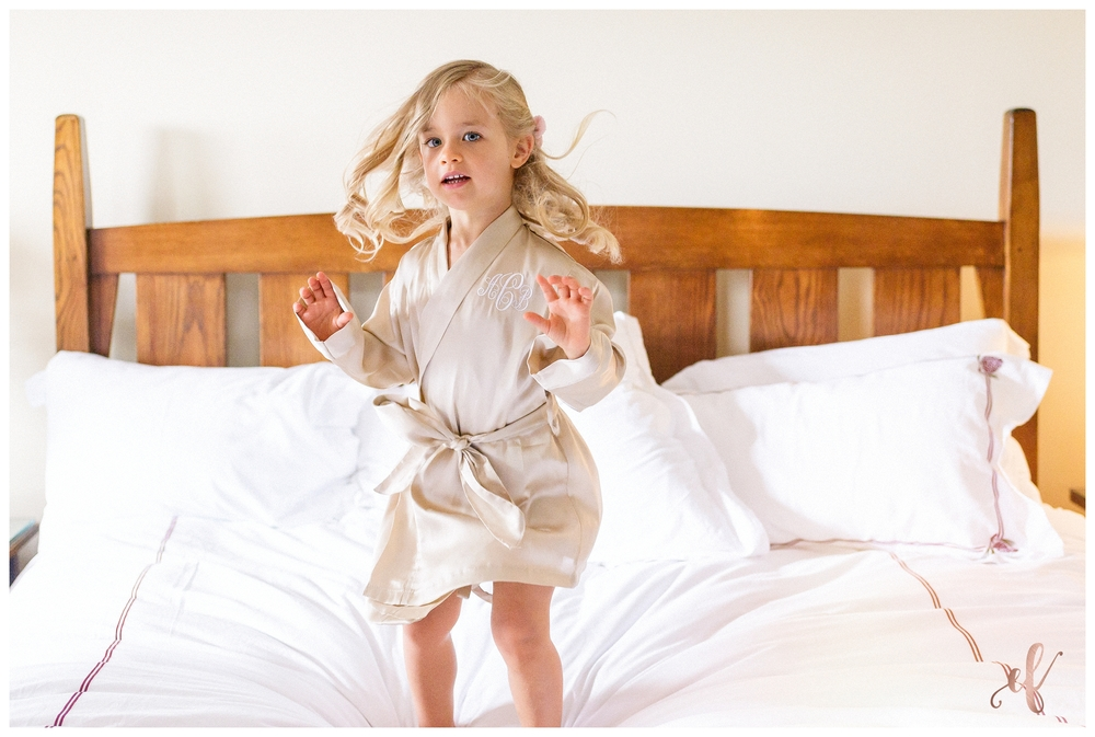 San Diego Wedding Photographer | Ernie & Fiona Photography | Flower Girl jumping on bed
