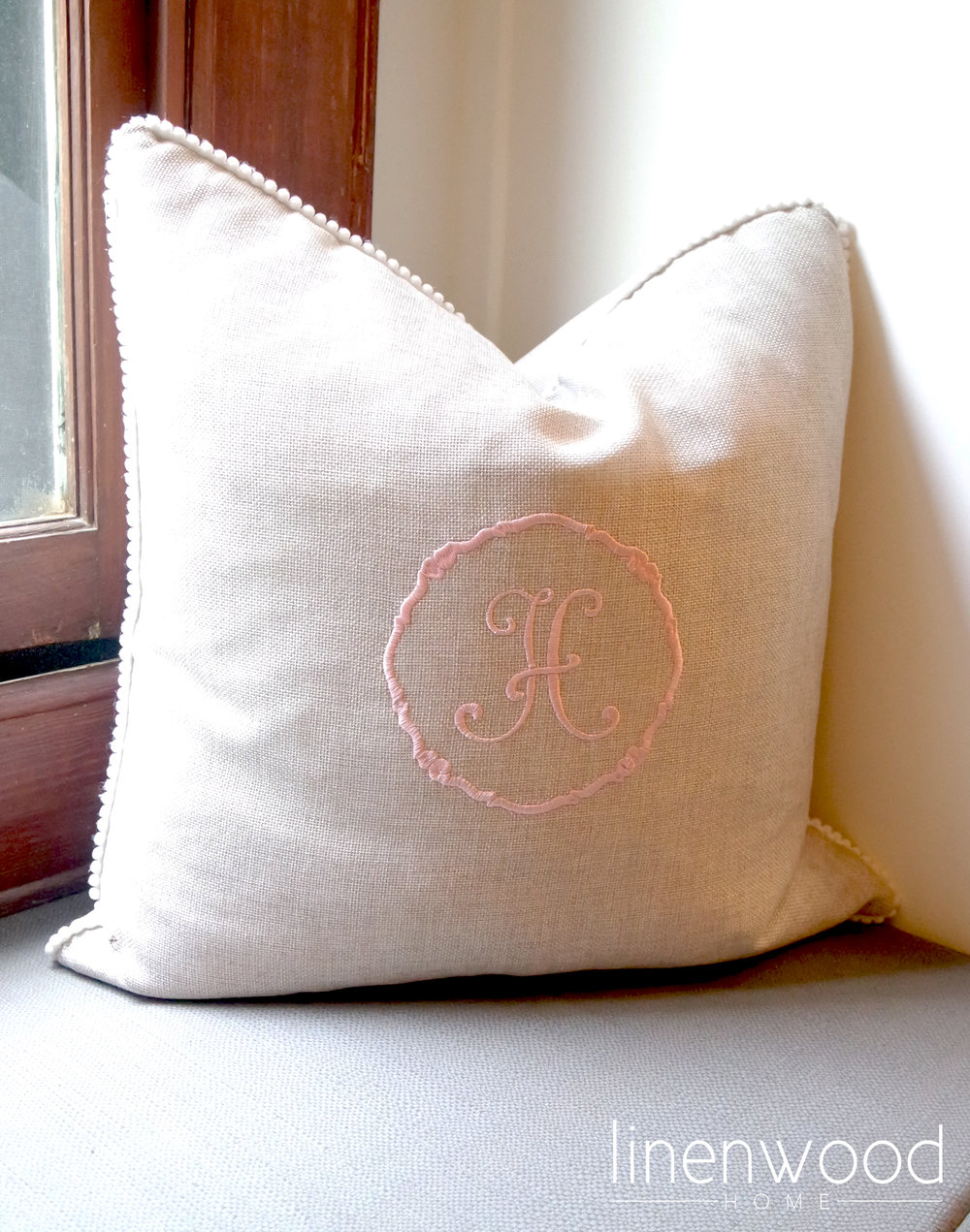 Custom pillows were created with the girls initials in soft pink.