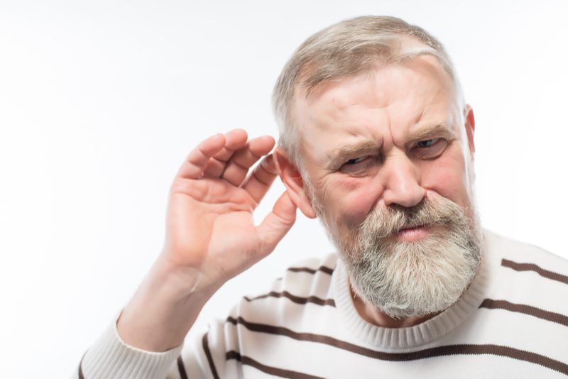 Hearing specialist - older person listening.