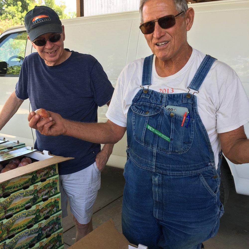 Dad with Farmer Al and a Dapple Dandy pluot