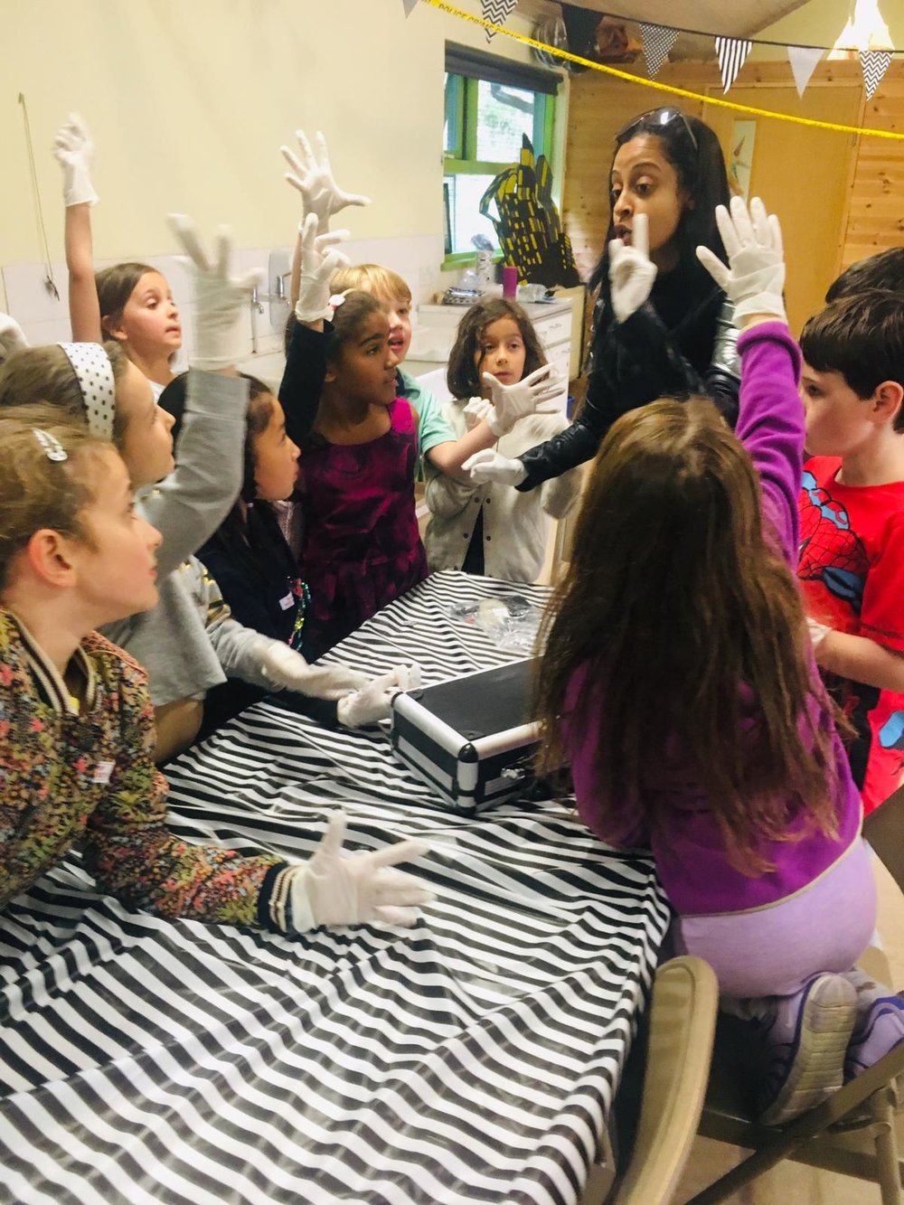 Time to find the culprit… - The kids learn how to lift fingerprints from the crime scene and identify the criminal by comparing handwriting!