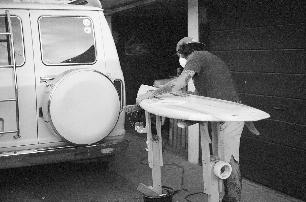 My buddy Marcos fixing a retro board he picked up for $75. Right before I left. Pacific Beach 2016