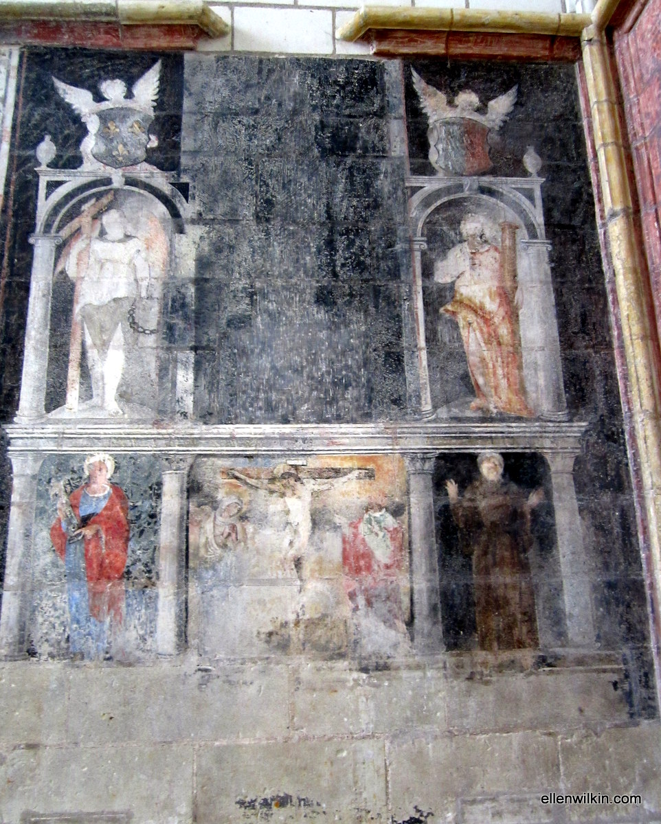 Vivid colors on the stone walls of the chapel at the Chateau d'Angers, the remains of paintings of Jesus, Mary, angels, and various other holy figures.