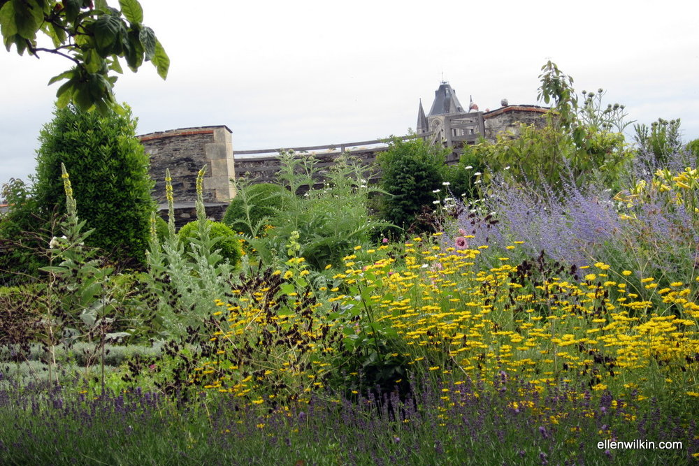 Looking through the gardens atop the earthworks toward the opposite castle wall.
