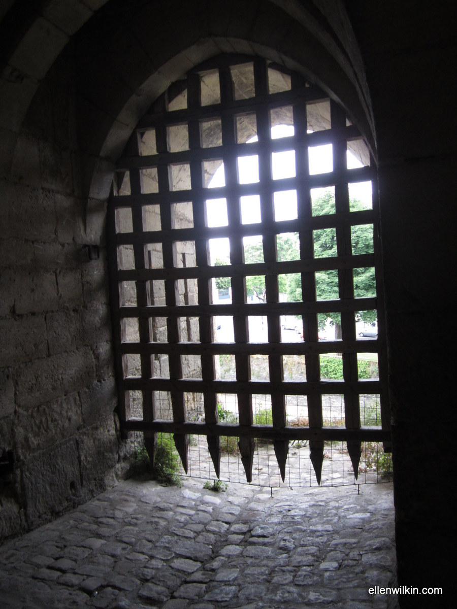 The portcullis at the field entrance on the south side of the Chateau d'Angers. This was the original entrance way. Notice the barbed wire over the bottom of the portcullis. It certainly won't keep rabbits or weasels out!