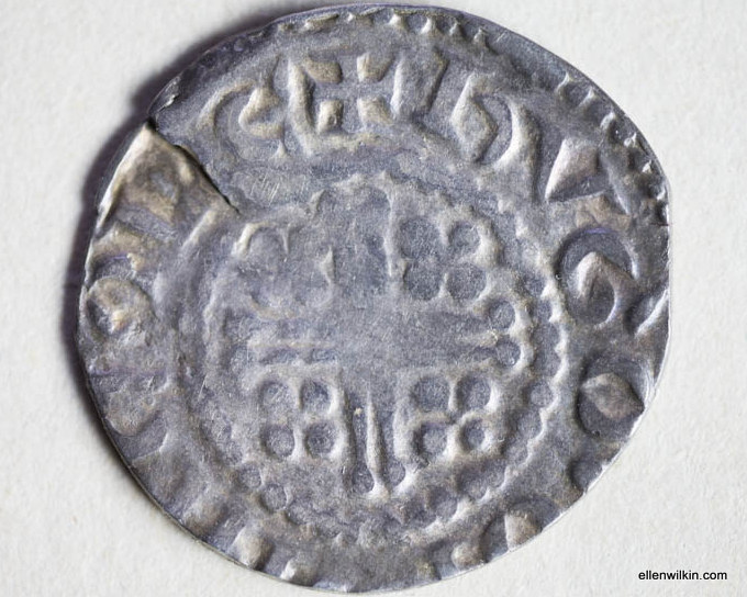 """The tail's side of my Short Cross penny showing the actual """"short cross."""" The lettering is off, but it says it was minted by a man named Hugo in Lincoln, England."""