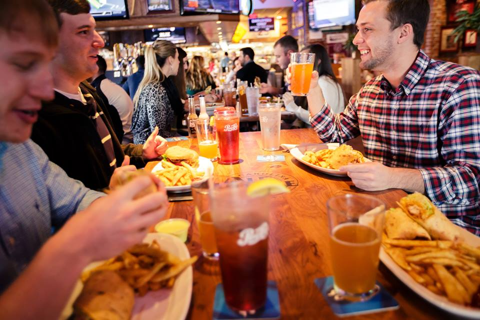 Customers enjoy a meal and drinks at the Carolina Ale House.