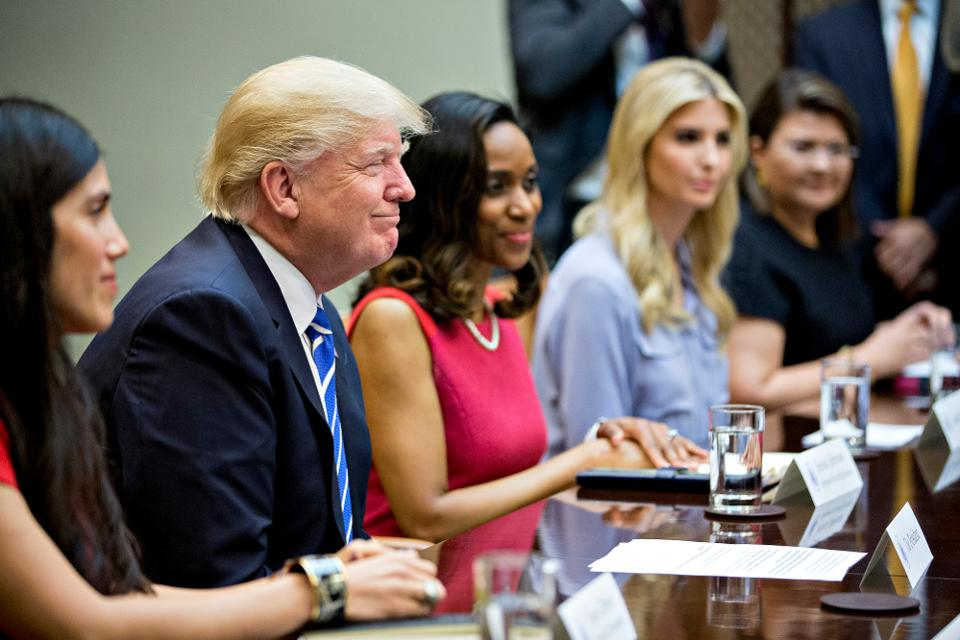 Claudia Mirza, co-founder and chief executive officer of Akorbi, from right, Ivanka Trump, daughter of U.S. President Donald Trump, Jessica Johnson, president of Johnson Security Bureau Inc., President Trump and Dyan Gibbens, founder and chief executive officer of Trumbull Unmanned, listen during a meeting with women small business owners in the Roosevelt Room of the White House on March 27, 2017 in Washington, D.C. (Photo by Andrew Harrer-Pool/Getty Images)