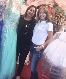Kimberly Guest-Hernandez (right) poses with Maria Magana, owner of a bridal and special event apparel and accessory shop in Houston, Texas.