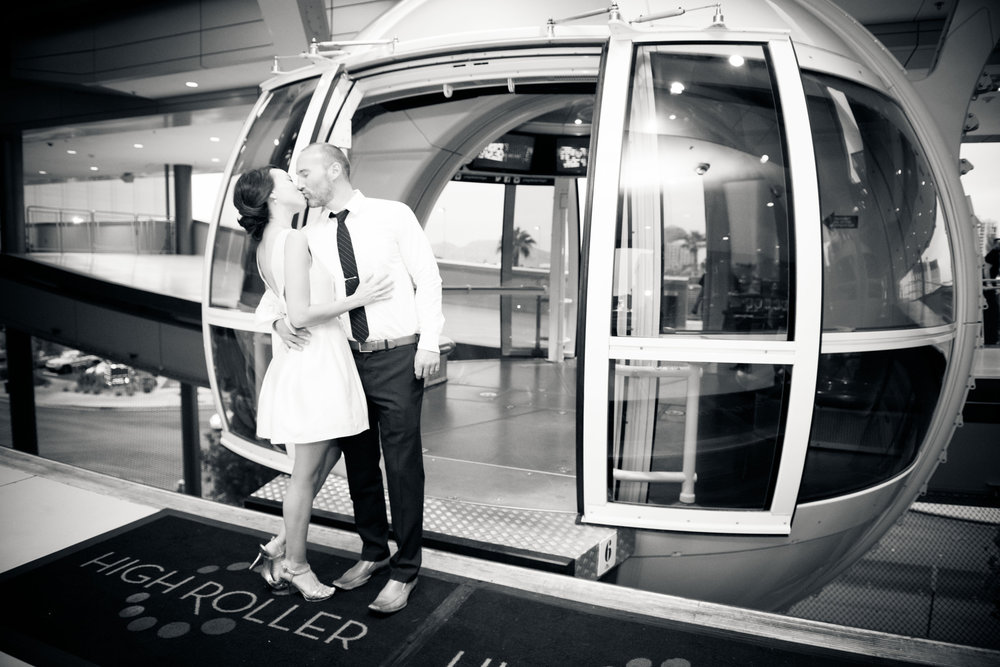 Groom Kisses his bride in front of High Roller cabin