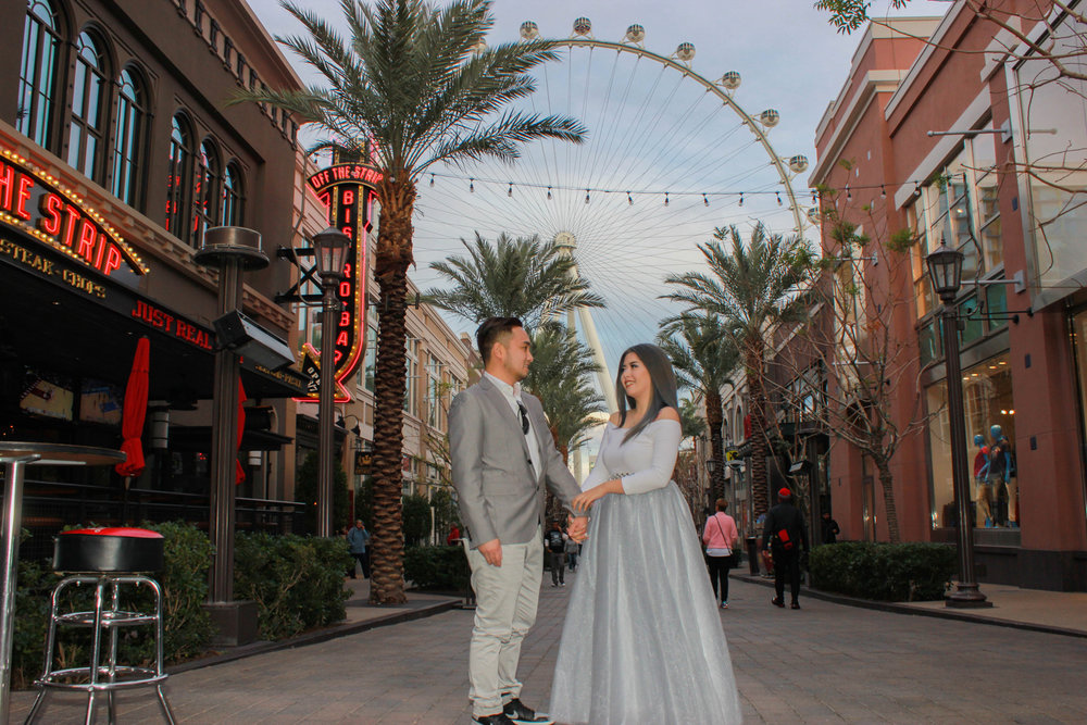 Newlyweds pose in front of the High Roller observation Wheel