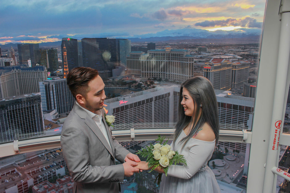 A bride and groom hold hands during their high roller wedding ceremony