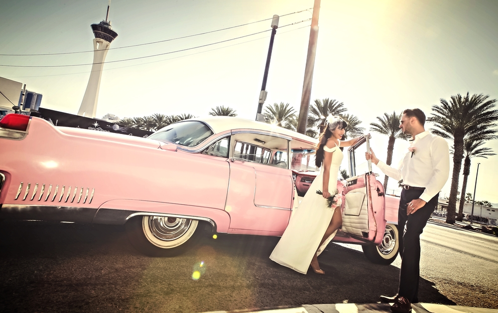 PINK CADILLAC WITH BRIDE AND GROOM