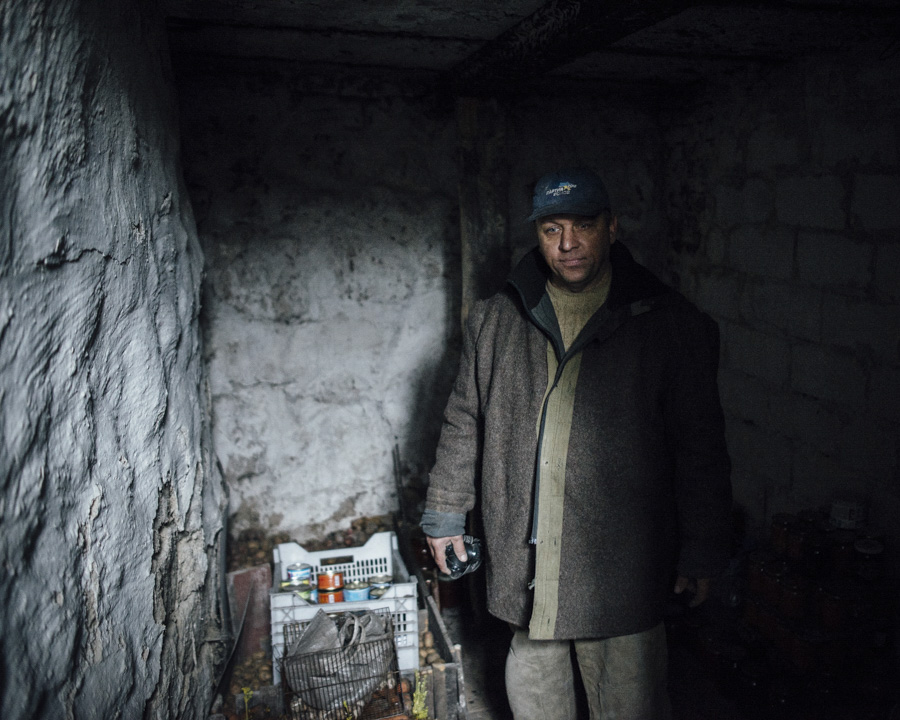 Sergiy, a former Taxi driver, is staying in the hideout in Karlivka where the family used to go when shelling starts.