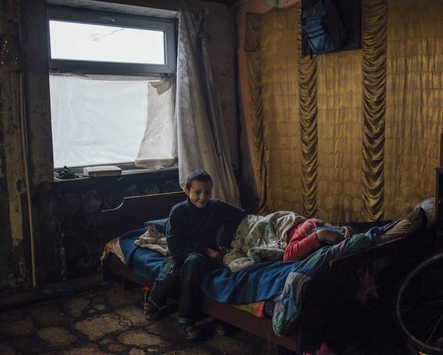 Rama and Zhenya spending most of their time at home, since most of the schools and kindergarten shut down during the conflict, with their other siblings (9 in total).