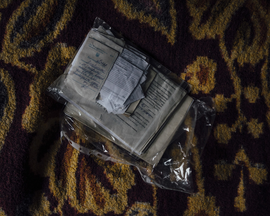 A small bag with the Documents of Nikolais family. Everything necessary is selected and wrapped in the bags to take it when they need to flee.