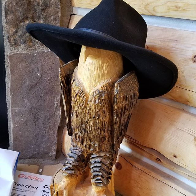 J-M commandeered this carving of an eagle to serve as his hat stand today. HAD to get a pic! . . #jennuine #jennuineknits #colorandlife #colorandlifepodcast #coloringlife #fiberjenn #colorfullife #mountainknitters #hats #hatstands #uniquehatstands