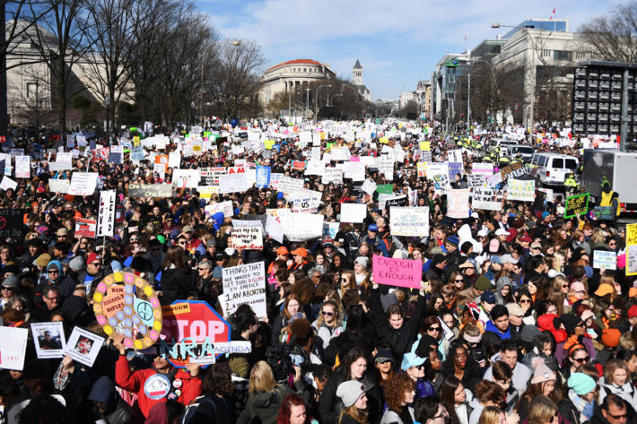 Protesters carrying signs at the March for Our Lives in Washington D.C on March 24, 2018.