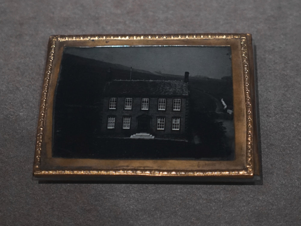 Framed ambrotype of Haworth parsonage circa 1850.