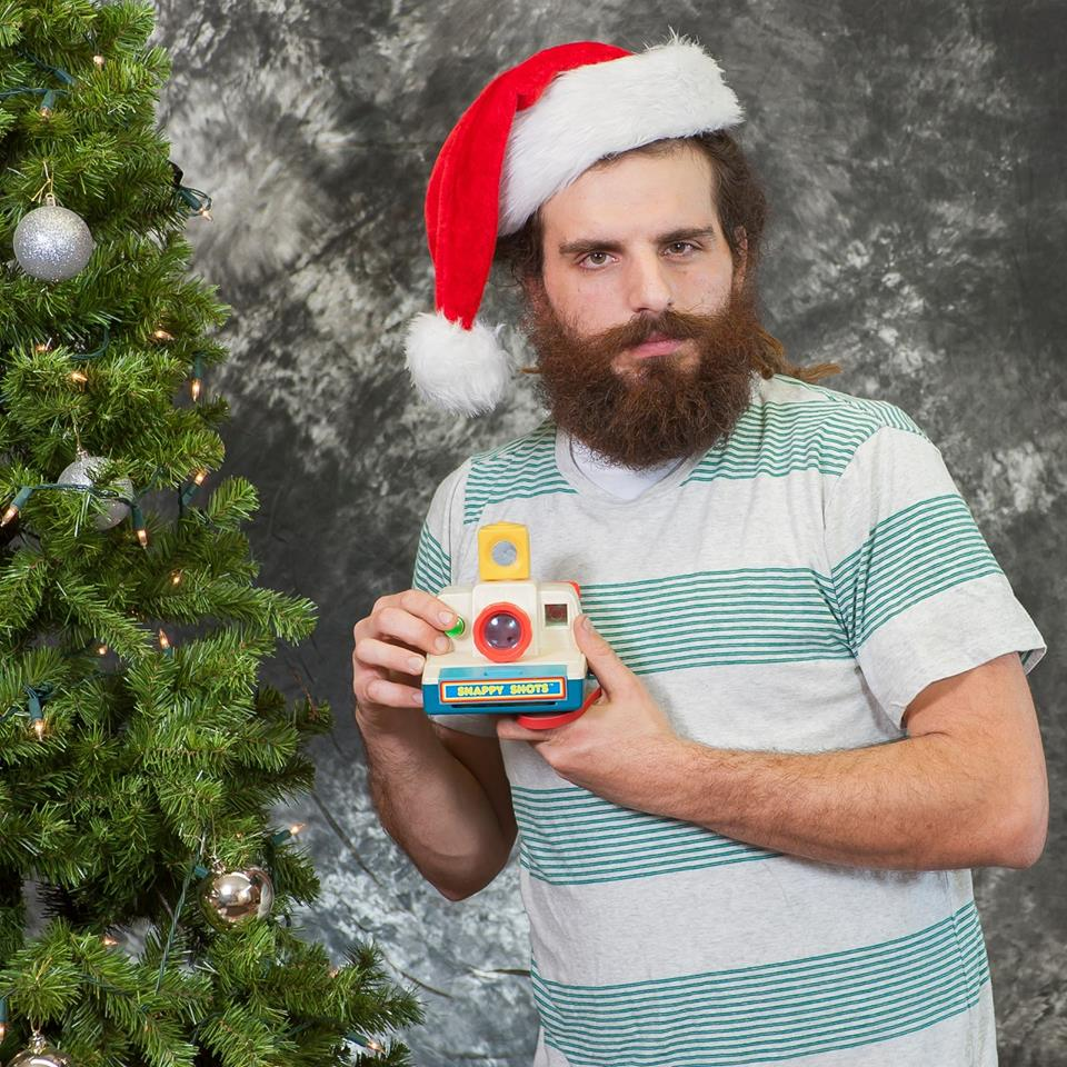 Christmas portrait of me holding my first ever childhood camera. (Do not be alarmed. This is not the camera I use to photograph weddings.)     Nikon D700, 80mm @ f5.6, Tripod mounted