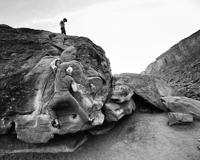 Education comes in many forms...Coach and student in Moab, Utah. #problems #teach #coach #strength #getoutside #dowhatyoulove #explore #freshair #gapyear #moab #utah #rock #climb #boulder #photography #blackandwhite