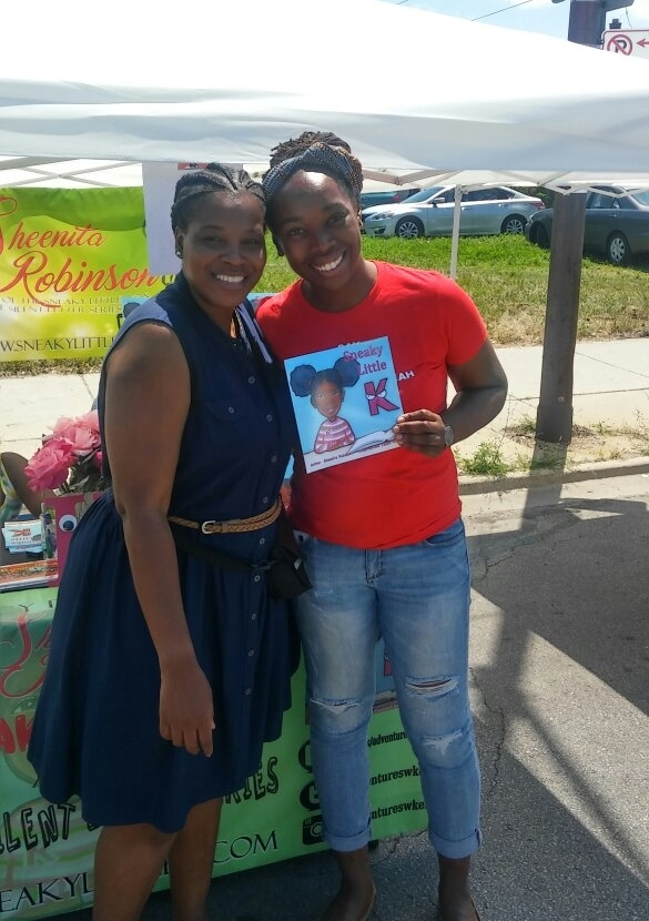 Robinson at the Soulful Chicago Book Fair with a friend, supporting  Sneaky Little K.