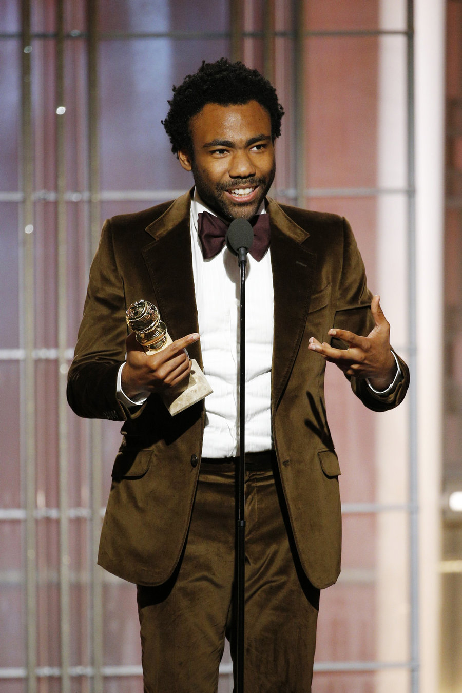 Glover accepting his Best Male Actor award.